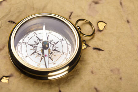 Compass on the old paper background Stock Photo - 13503162