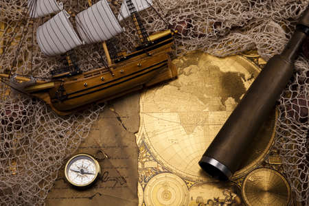 Antique brass compass over old map Stock Photo - 13503222
