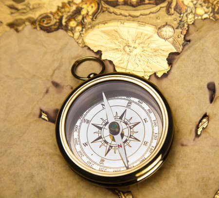 Old style compass and paper background Stock Photo - 13503130