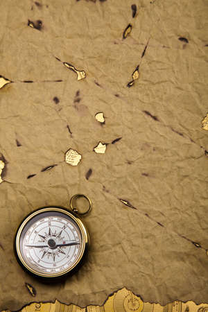 compasses: Old style compass and paper background
