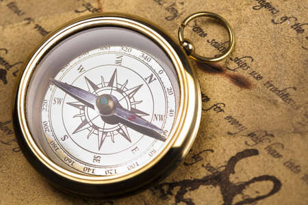 nautical compass: Compass on the old paper background