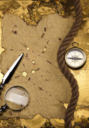 Old style compass and paper background photo