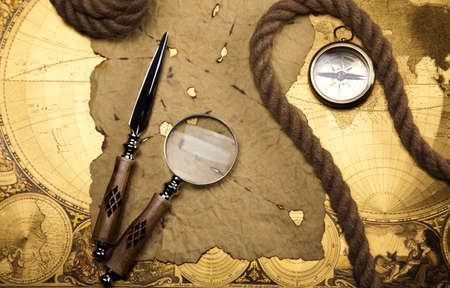 Old style compass and paper background Stock Photo - 13503187