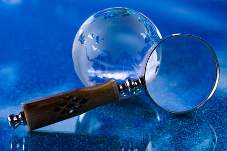 Globe and Magnifying glass photo