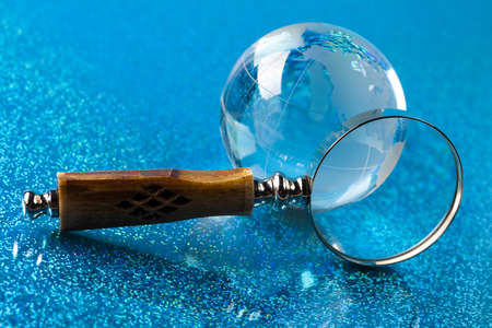 Magnifying glass and globe photo