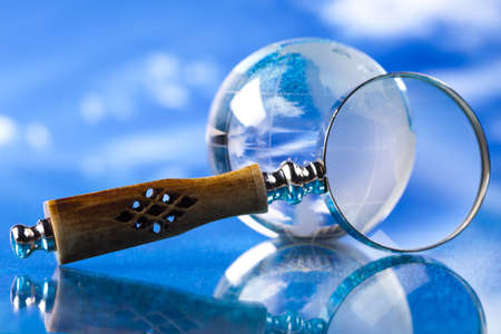 Magnifying glass and globe Stock Photo