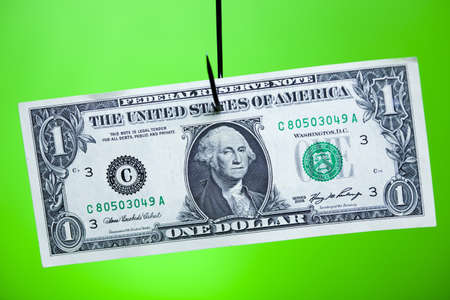 Dollar sign on piece of paper on hook Stock Photo - 13503690