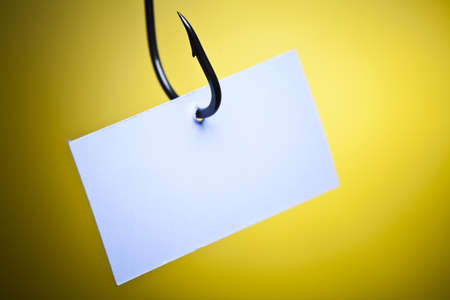 color image fish hook: Blank on piece of paper on hook Stock Photo