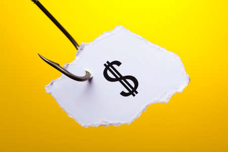 Dollar sign on piece of paper on hook Stock Photo - 13502446