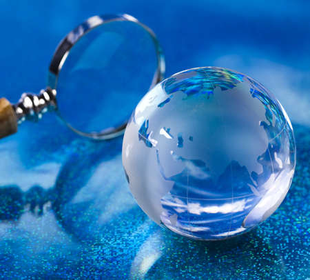 Travelling, magnifying glass and globe Stock Photo - 13501845