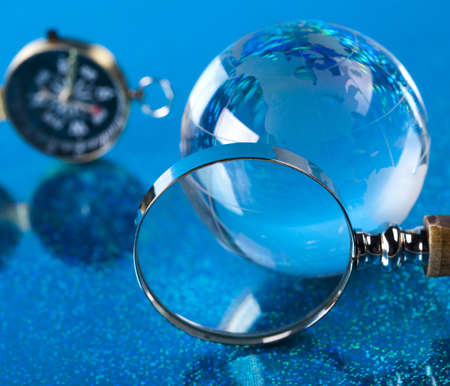 Magnifying glass, Compass and globe photo