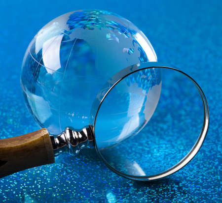 Travelling, magnifying glass and globe photo