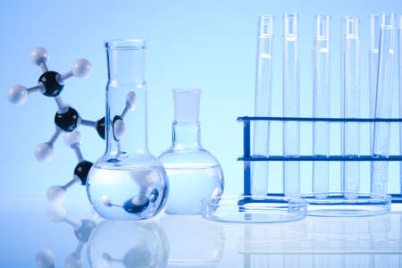 Glass laboratory equipment with blue background photo