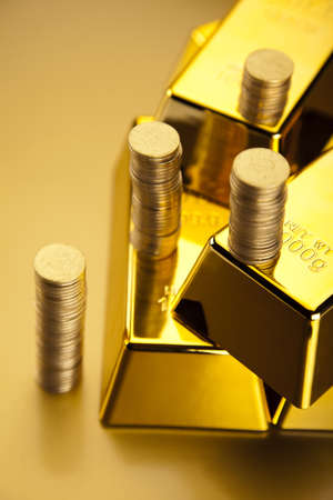 Gold bars and coins  photo