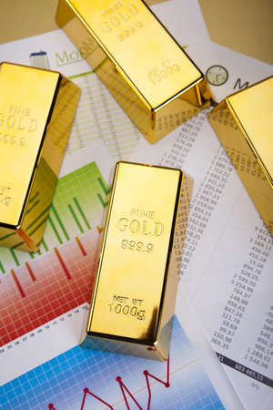 Gold Ingot on a Chart Stock Photo - 13342256