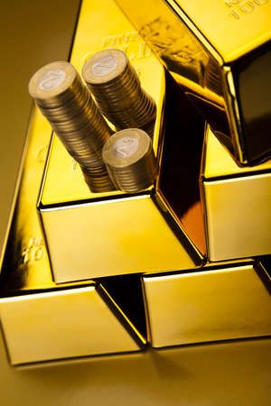 Coins and gold bars, Finance Concept photo