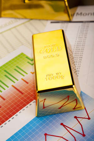 numismatist: Financial indicators,Chart, Gold bar Stock Photo