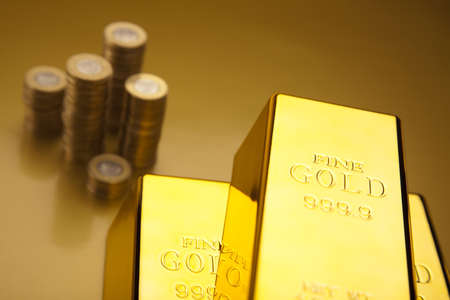 numismatist: Coins and gold bars Stock Photo