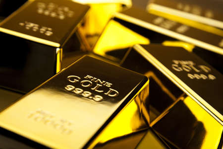 numismatist: Stack of gold bars Stock Photo