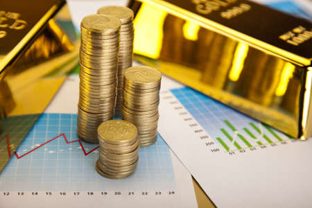 numismatist:  Coins and gold bars, Finance Concept Stock Photo