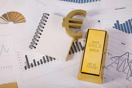 numismatist: Financial indicators,Chart,Gold bar,money Stock Photo