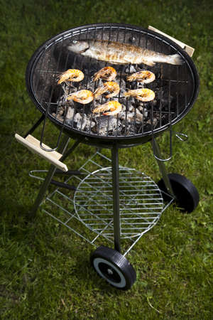 Grilling fish and shrimps photo