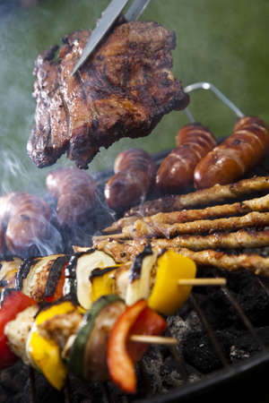 Closeup of meat on grill photo