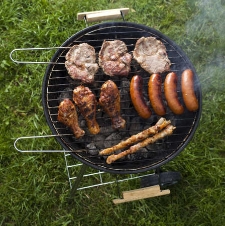 Barbecue a hot summer evening, Grilling  Stock Photo - 14217817