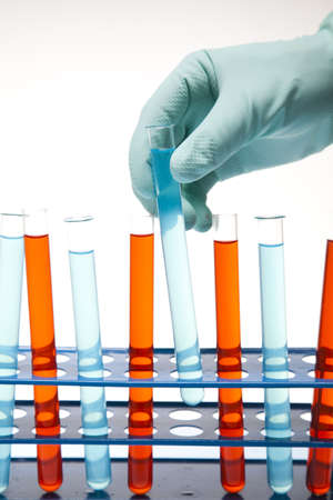 Scientist working in a laboratory , glass containing liquid color Stock Photo - 14218282