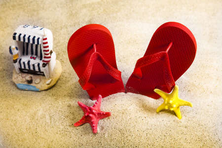 Sand beach and flip flops photo