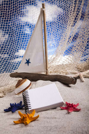 Copyspace blank paper on white beach photo