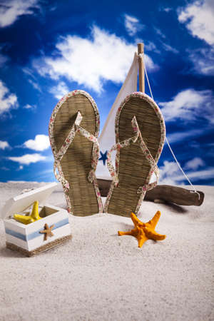 Flip-flops on a sandy beach  photo