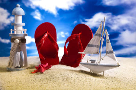 Flip flops and  sand  photo