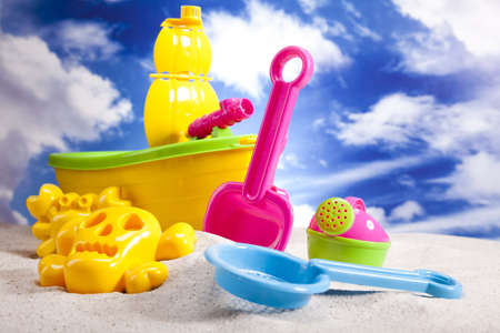Colorful plastic toys on the beach photo