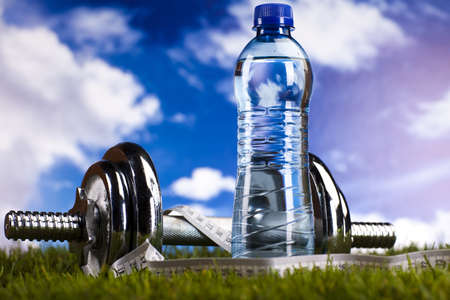 toning: Dumbbells, apple, measure tape and bottle water