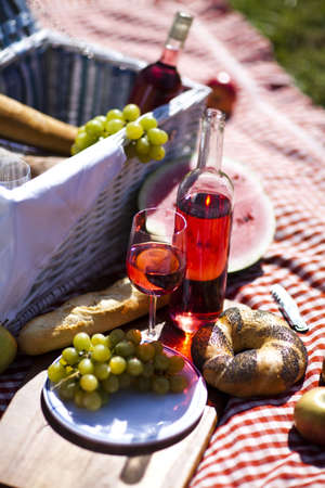 Wine and picnic basket on the grass Stock Photo - 15243721
