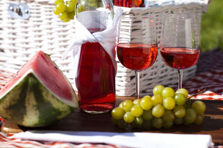 Wine and picnic basket on the grass  Stock Photo - 15243615