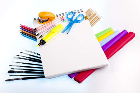 learning materials: School tools on a white background