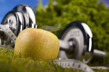 Apple with measuring of dumbbell photo