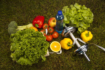 Vegetable and fitness in green grass photo