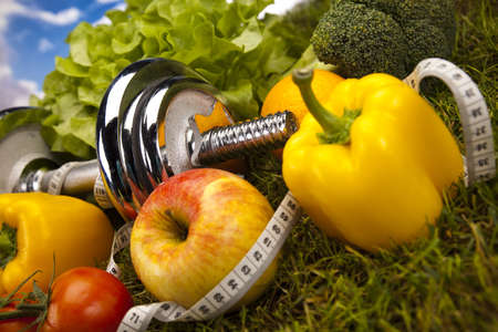diet concept: Vegetable and fitness in green grass
