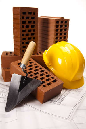 Brick, yellow hard hat, tools photo