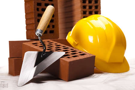 Hard hat with bricks and trowel Stock Photo - 16408894