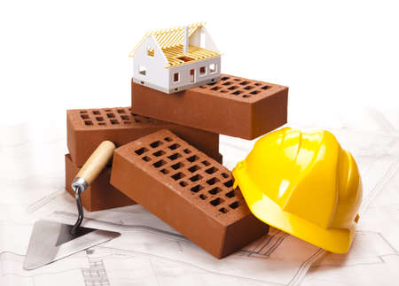 Building house, trowel and bricks Stock Photo - 16391697