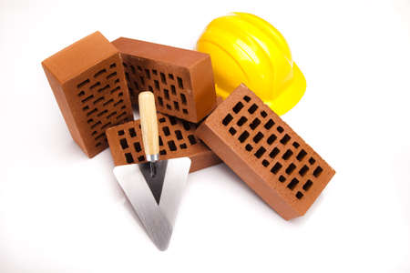 Building background, trowel and bricks photo