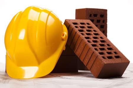 Brick, yellow hard hat photo
