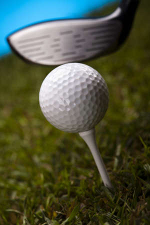 Golf ball on green grass over a blue background Stock Photo - 17487121