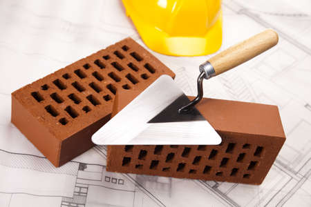 Building house, trowel and bricks photo