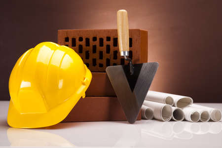 Brick, trowel tool and Construction plans Stock Photo - 17486903