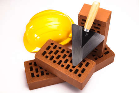 Brick, yellow hard hat, tools Stock Photo - 17487007